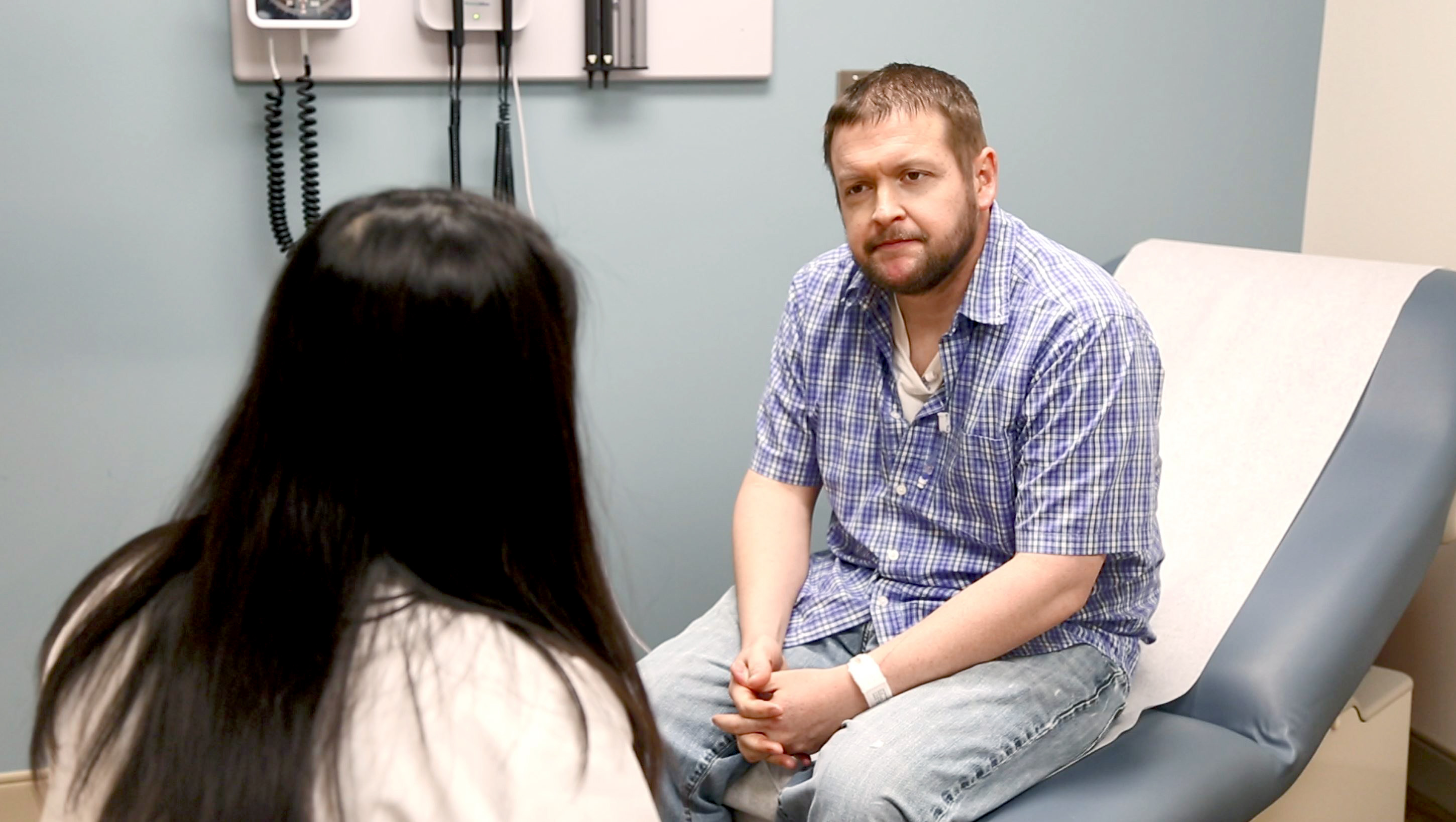 Oncologist talking with patient
