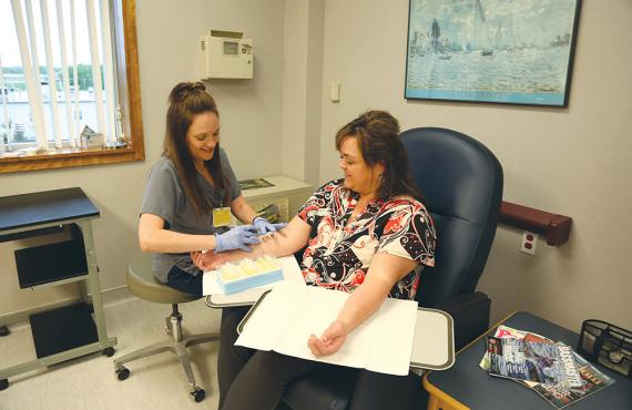 Nurse giving patient an allergy test