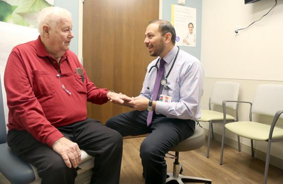 Dr. Guerrero-Garcia talks with a patient at the Phelps Health Delbert Day Cancer Institute (DDCI).