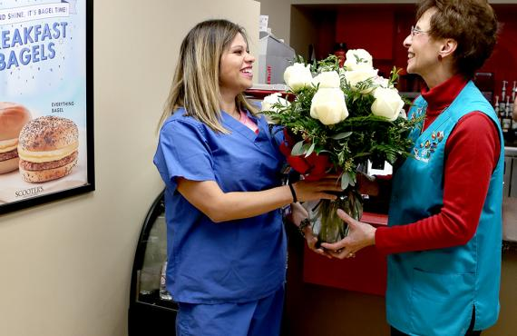 Volunteer giving flowers