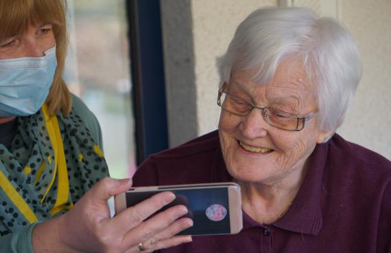 senior patient looking at phone